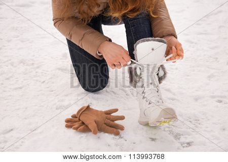 Closeup On Woman Tying Shoelaces Without Gloves Outdoors