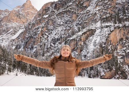 Happy Woman Outdoors Among Snow-capped Mountains Rejoicing