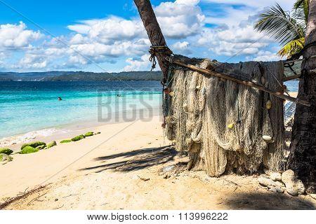 Fishing nets dry under the palms on Samana