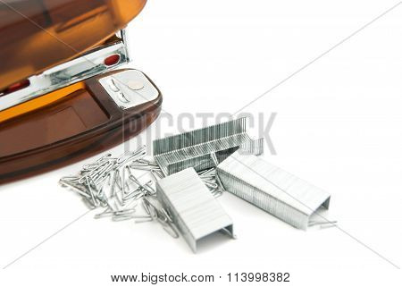 Orange Stapler And Staples On White