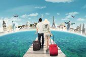 Постер, плакат: Couple Carrying Luggage On The Bridge
