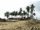 stock photo of tomas  - mud slide clean up from hurricane Tomas homes on beach Soufriere St - JPG