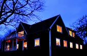 stock photo of winter scene  - winter night scene of a house with the lights on - JPG
