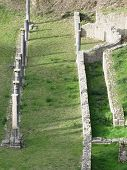 Постер, плакат: Ruins Of A Antique Roman Amphitheater In Volterra Province Of Pisa Tuscany Italy