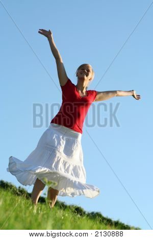 Woman Spreading Arms To Sky