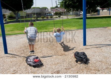 Brothers On Swing Set