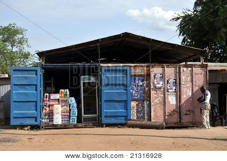 JUBA – JUNE 10: Unidentified men standing in front of containers turned into a shop in Juba, capital of South Sudan, on June 10, 2011. Containers are used in Juba for everything from shops to hotels.