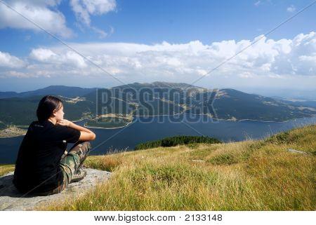 Girl Looking A Lake