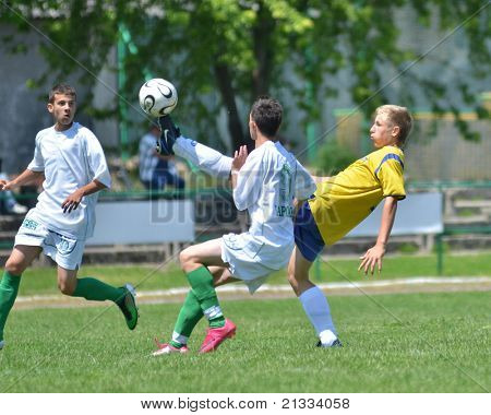 KAPOSVAR, HUNGARY - JUNE 11: Konrad Kiss (9) in action at the Hungarian National Championship under 17 game between Kaposvari Rakoczi FC and Bajai LSE on June 11, 2011 in Kaposvar, Hungary.