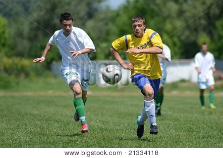 KAPOSVAR, HUNGARY - JUNE 11: Konrad Kiss (L) in action at the Hungarian National Championship under 17 game between Kaposvari Rakoczi FC and Bajai LSE on June 11, 2011 in Kaposvar, Hungary.