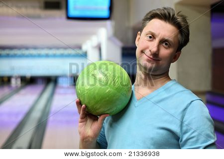 Portrait of man with ball for bowling