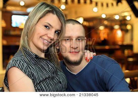 Beloved couple sits on bench during rest in club