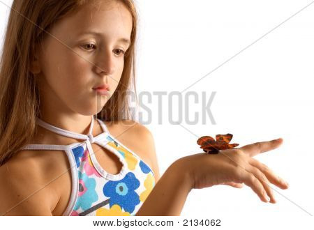 Portrait Of Girl With Artificial Butterfly