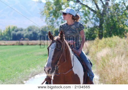 Woman Riding Paint Horse