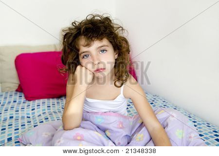 brunette girl bored in her bedroom bed with messy hair