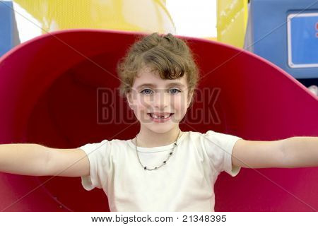 blue eyes indented girl smiling in red playground