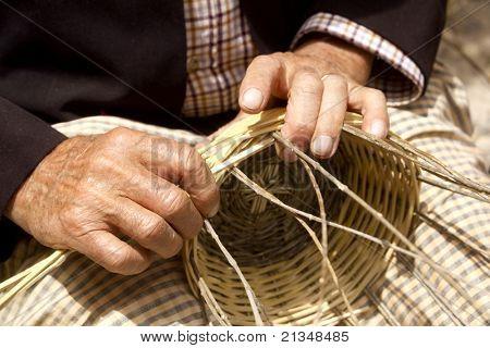 craftsman hands working basketry in Mediterranean  Balearic islands