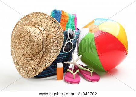 Beach items with straw hat,towel,flip flops,sunblock,beach ball and sunglasses.