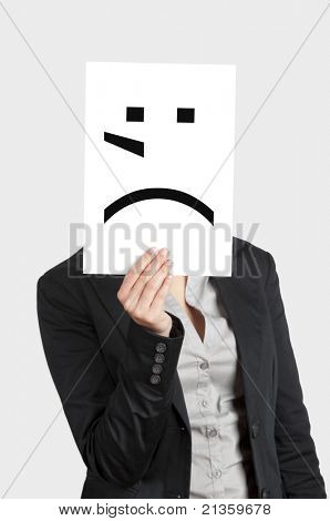 Woman showing a blank paper with a crying emoticon in front of her face