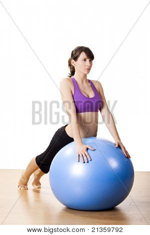 Beautiful young and athletic woman making exercises on a fitness ball