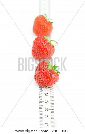 Measure Tape And Strawberries Isolated On White