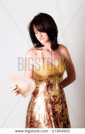 sexy image of beautiful young brunette model holding a white with Chinese hand fan in her hand