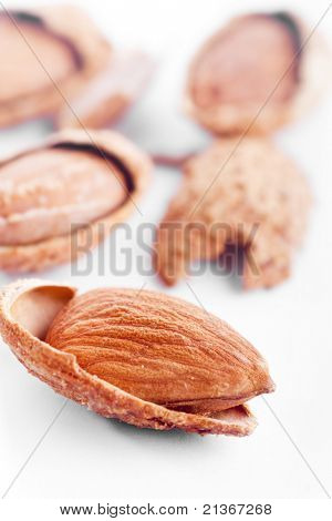 Close up almond nuts, focus on foreground and shallow depth of field.