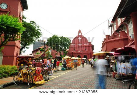 Tourist activity in front Christ Church. Christ Church is in the main square adjacent to Stadthuys, Melaka, Malaysia.