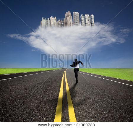 businessman running to the future city