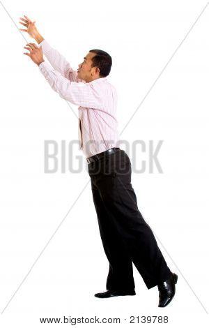 Business Man Reaching Up