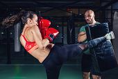 Boxing Class. Woman Training Boxing With Male Trainer. Toned Image poster