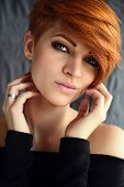 Portrait Of A Beautiful Young Red-haired Woman With Short Hair poster