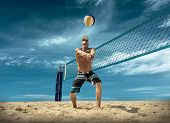 Beach volleyball player in action at sunny day under blue sky. poster