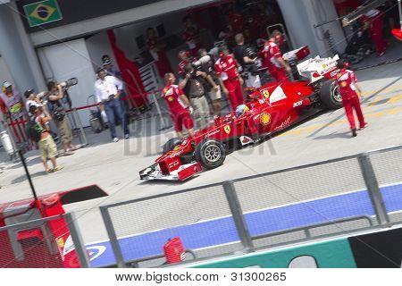 Fernando Alonso exits his pit garage