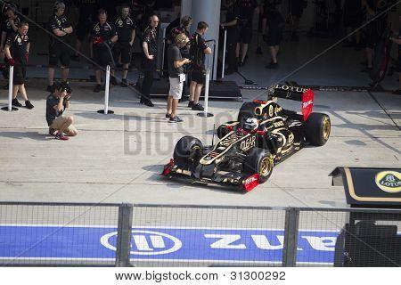 Kimi Rakkonen exits his pit garage