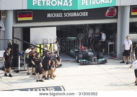 Michael Schumacher exits his pit garage