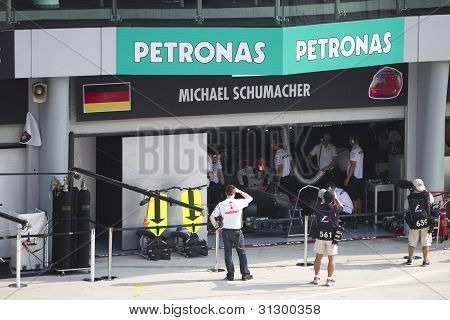 Michael Schumacher enters his F1 car for Friday practice