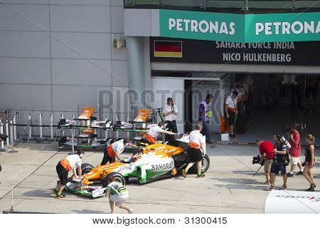 Nico Hulkenberg pushed back to his pit garage