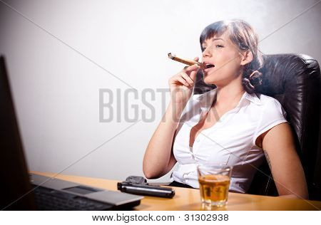 Businesswoman relaxing in her office