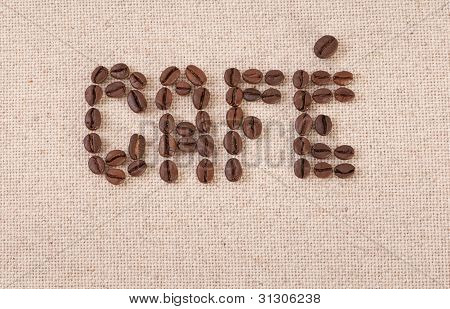 Cafe Written With Coffee Beans On Canvas