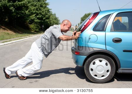 Man Pushing A Car