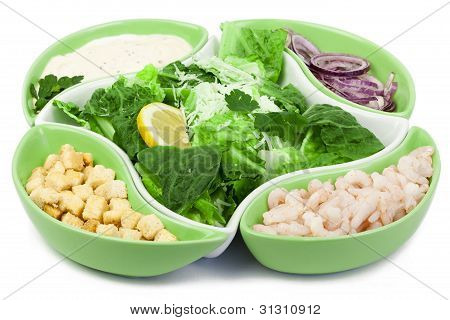 Caesar salad with shrimp on a white background