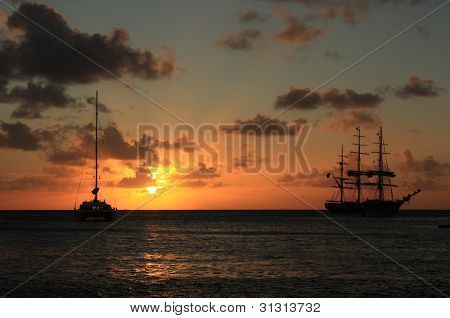 Caribbean sunset and silhouett of the ship