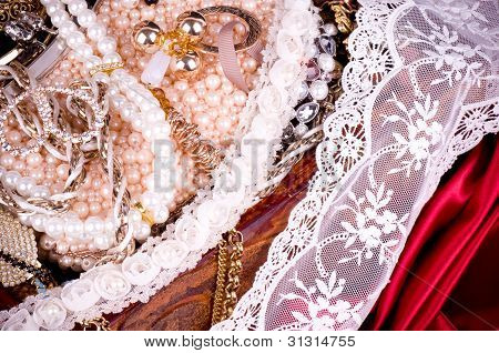 Gold jewelry and pearls background, with lace