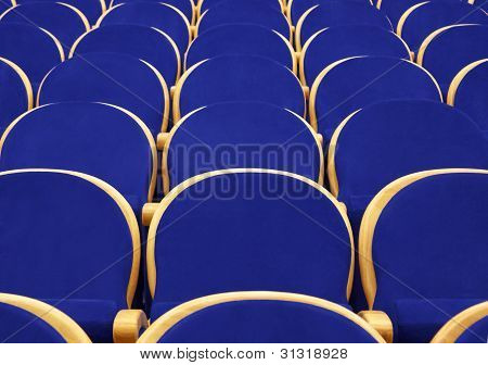 Empty Concert Hall With Blue Chairs