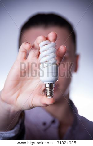 Person Holding Energy Saving Lamp