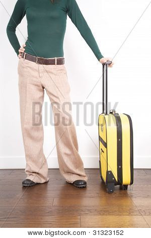 Waiting With Yellow Suitcase
