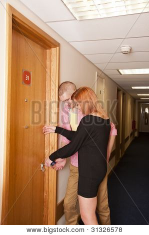 Couple entering hotel room