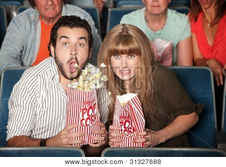 Couple Spills Their Popcorn