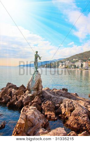 Opatija In Croatia. Sculpture Of The Woman With The Sea.